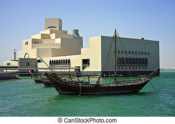 Dhow and museum - A dhow moored in front of the Museum of...