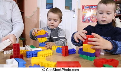 children play designer - constructor kids play at the table