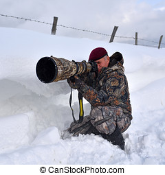 professional photographer outdoor in winter on harsh weather