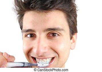 Cute guy washing his teeth