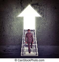 Businessman climbing up stairs - Businessman climbing up...