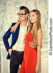 elegant couple - Gorgeous couple of young people stand in a...