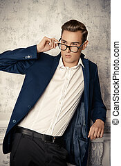 man in spectacles - Vogue shot of a handsome elegant man in...