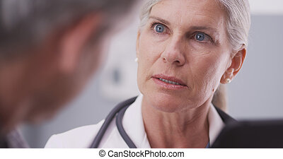 Close-up of medical doctor talking - Close-up of medical...