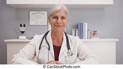 Attractive mature doctor smiling