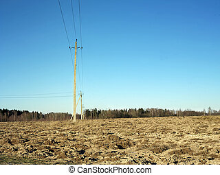 Electric Line In Field - Electric posts across a plowed...