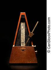 Vintage metronome - Vertical shot of a vintage metronome, on...