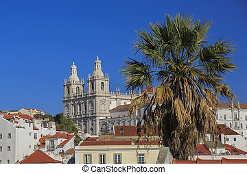 Igreja de Sao Vicente de For a in Lisbon and house roofs,...