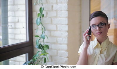 Young business lady decides on smartphone HD