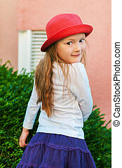 Outdoor portrait of a cute little girl of 5-6 years old...