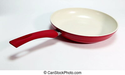 Red frying pan Close up on a white background