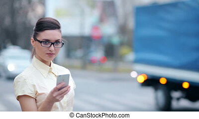 Business lady with phone on the street