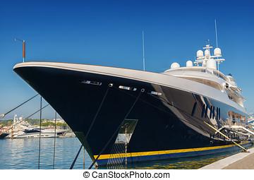 big luxury yacht moored in a marina