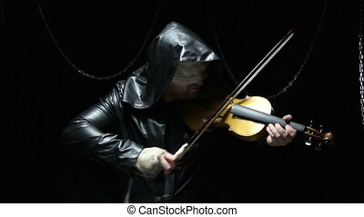Blind man in cloak with fiddler, video on black background