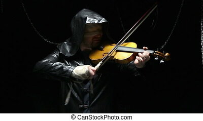 Blind man in black cloak with fiddler, video on black...