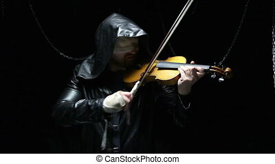 Blind man playing the fiddler, video on black background