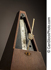 Vintage metronome - Color shot of a vintage metronome, on a...