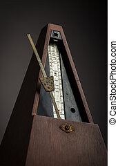Vintage metronome - Color shot of a vintage metronome, on a...