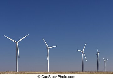wind energy - windfarm fied with blue sky