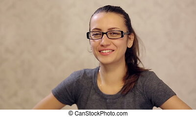 Woman in Glasses Laughing at a Joke - attractive girl in...
