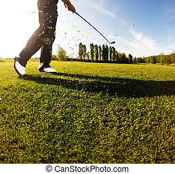 Golf swing on the course. Golfer performs a golf shot from the f