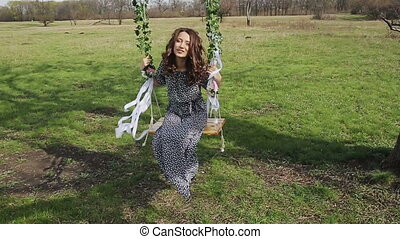 Happy Woman on a Swing