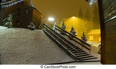 Snowing at night on the background of a lamppost Timelapse -...