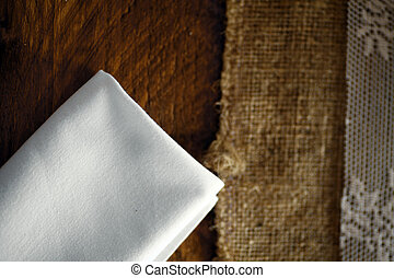 White napkin - Color picture of a white napkin on a table.