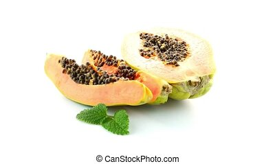 Slices of sweet papaya on white background