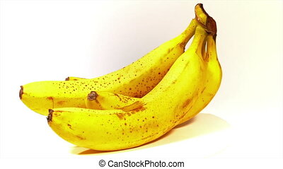 Looped: bunch of ripe tasty yellow bananas spinned