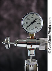 Manometer - Macro of a manometer isolated on grey background