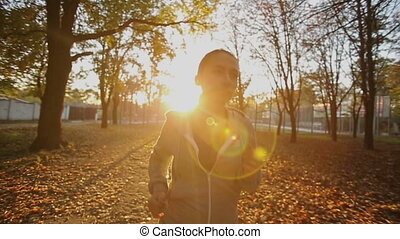 Sportswoman Runs Straight - woman running in park at sunset