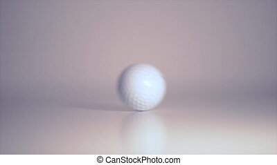 Golf Ball rolling over white close-up shallow depth of field
