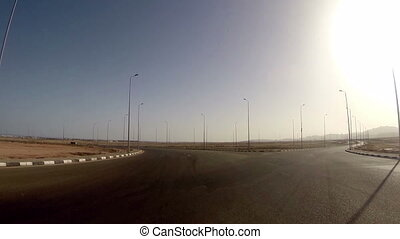 View from moving car on highway in desert of Egypt