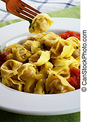Delicious Meat Cappelletti in with Tomatoes Sauce and One on...