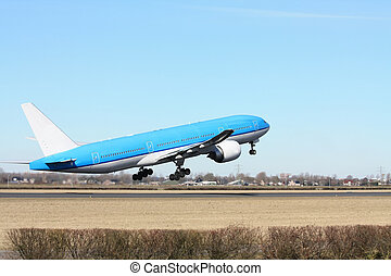 Plane taking off - A two engine aircraft in a clear blue...