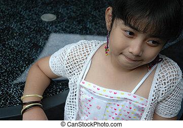 little girl sit down on chair - little asian girl sit down...