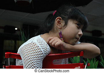 little girl sit down on chair - little asian girl sit down...