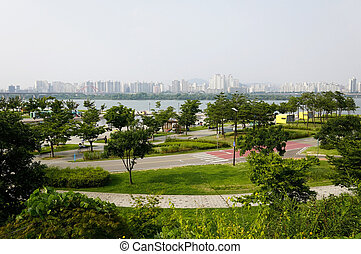 Hangang park in Seoul - Hangang park with river in the...