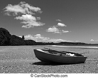 Fishing boat on a sandy beach during summer holiday...