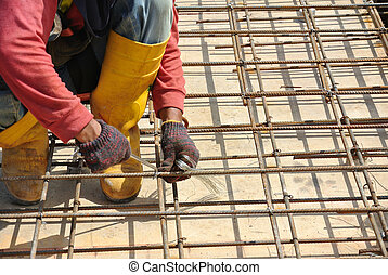 Install slab reinforcement bar - Construction workers...