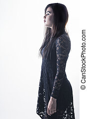 Model with black dress side view