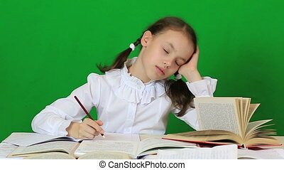 Sad girl writing, reeding Child doing homework Slow motion -...