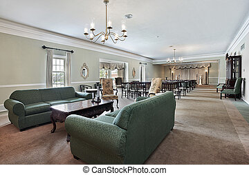 Funeral home with couches and chairs - View inside funeral...