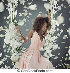 Pretty mulatto woman among white petals - Pretty mulatto...
