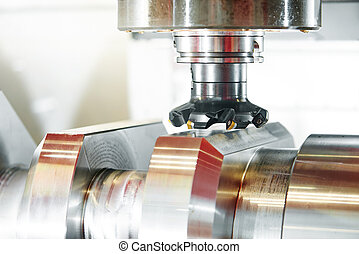 cnc metal working machining center with cutter tool during...