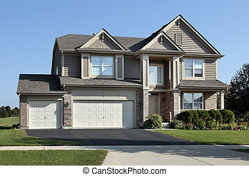 Brick home with arched entrance - Brick home in suburbs with...