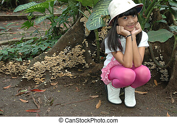 little girl sit down in park - little asian girl sit down in...