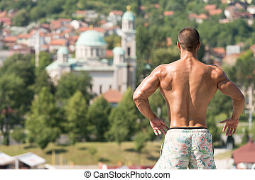 Physically Man Showing His Well Trained Back - Portrait Of A...
