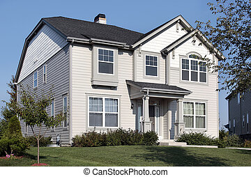 Home with gray and white siding - Home in suburbs with gray...